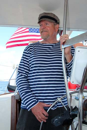 Captain Mac at the helm of Sailing Vessel Lionheart