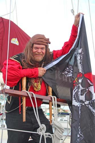 Capt. Mac Hoists the Gasparilla Colors